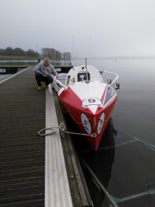 Alan Bustin Mulkern with the boat in which he is looking to row the Atlantic Ocean