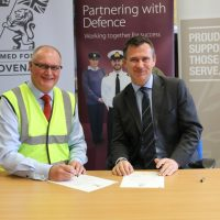 John Carter, Travis Perkins Chief Executive Officer, and Mark Lancaster TD MP signing the Armed Forces Covenant