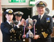 Lt Clare Read is pictured receiving the  President's Cup from Commander Charlie Bagot Jewitt