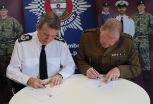 The Chief Constable of Derbyshire Police and Lieutenant Colonel David Dawber TD DL signing the Armed Forces Covenant in April 2017