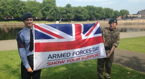 Cadets holding the Armed Forces Day flag