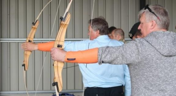 Employers take part in an archery activity during the Conversation with Cadets event