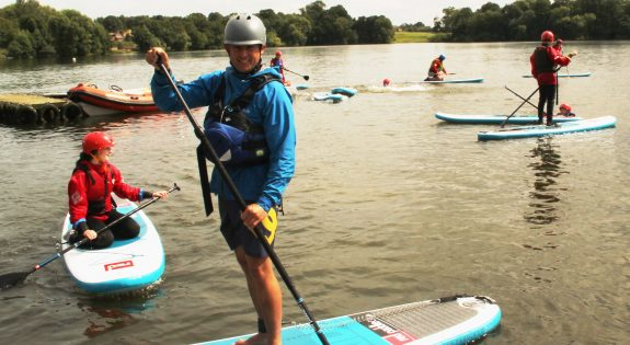 Ian Powell paddle boarding at Derbyshire ACF's summer camp