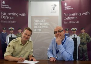 Lt Col Andrew Parker of 7th Infantry Brigade signs the Armed Forces Covenant with Total Motion's Managing Director Simon Hill
