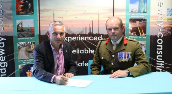 Managing Director Pino de Rosa and Col Peter Fisk sign the Armed Forces Covenant