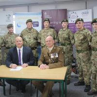 Principal Tim Croft and Lt Col Keith Spiers with cadets from the school's cadet unit