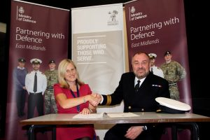 Thomas Estley Community College Principal Mandi Collins and Commander Martin Clegg after signing the Armed Forces Covenant