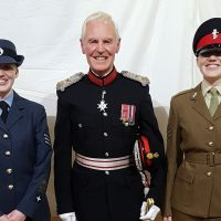 Lord Lieutenant of Rutland Sir Laurance Howard is pictured with RAF Air Cadet Amelia Seymour (left) and Army Cadet Hannah Seymour