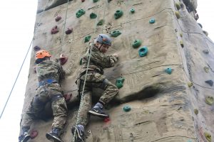 Derbyshire cadets using the climbing wall at summer camp