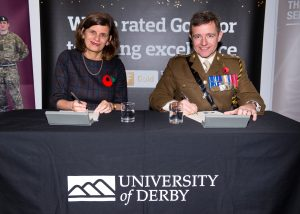 Professor Kathryn Mitchell and Lt Col Duncan Jenkins signing the AFC