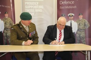 Jim Wright, Director, Wrights Logistic Service, signing the Armed Forces Covenant