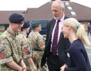 A cadet speaks to guests at the event