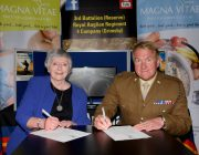 Chair Doreen Stephenson and Major Mitch Pegg  signing a covenant