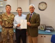 Captain Richard Griffin, Rob Juson and John Wilson after the covenant signing