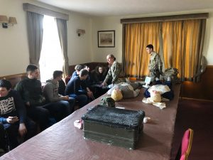 The students being taught about First Aid in the Army