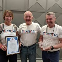 Cathy Thompson (left) and Rob Holland (right) with Blesma Member Martin Burns (centre).