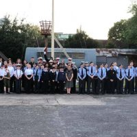 Sea Cadets and Royal Air Force Air Cadets assembled on the main deck of TS ORION