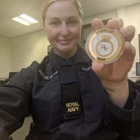 Reservist with commemorative coin