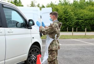 A young Reservist performing COVID-19 tests