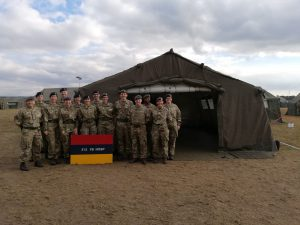 Members of 212 Field Hospital by their tent