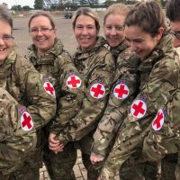 Members of 212 Field Hospital show their red cross arm bands