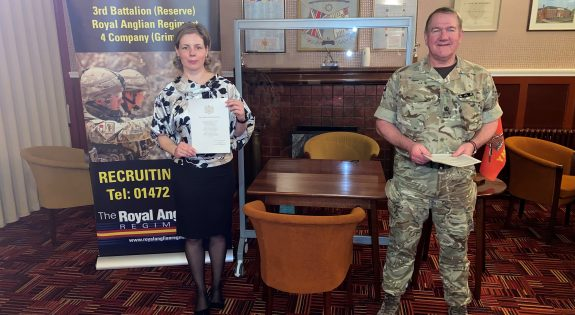 Private Bucur with her Oath of Allegiance certificate