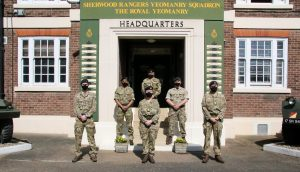 Soliders stand socially distanced outside Carlton Army Reserve Centre