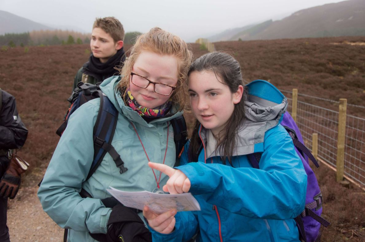 Cadets consult a map to find their route across the Moors.