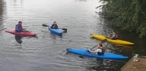Four canoes with Sea Cadets