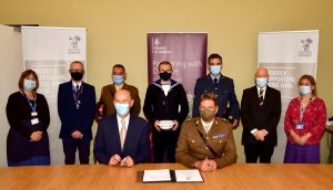 LLR ICS personnel signing the Armed Forces Covenant