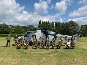 RAF Air Cadets in front of a Wildcat helicopter