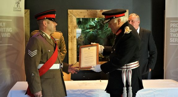 Sergeant Grant being presented with his certificate by the Lord Lieutenant
